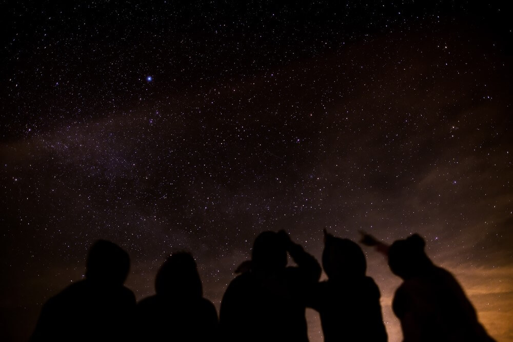 A Family star gazing at night time