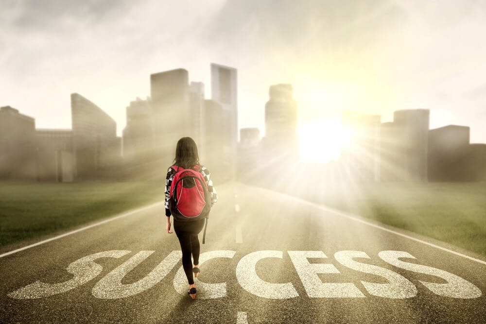 Woman walking down the road to success