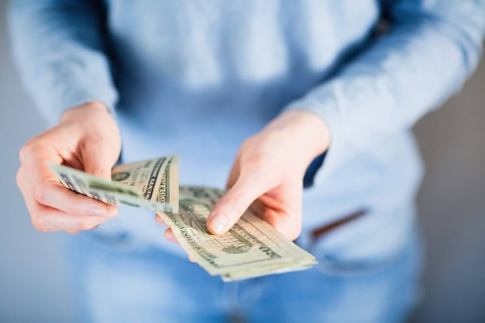 Counting cash from a car title loan