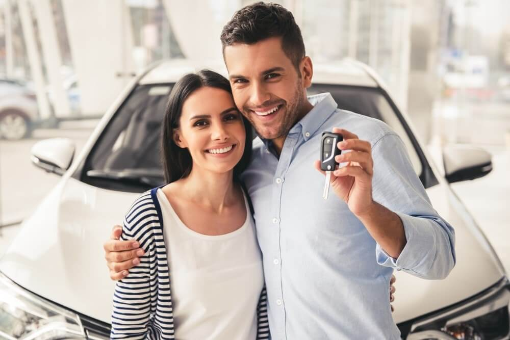Happy couple getting a car title loan