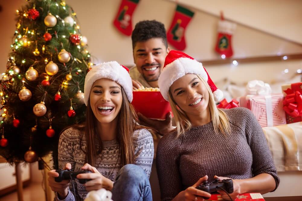 A group of friends plays video games during the holidays.