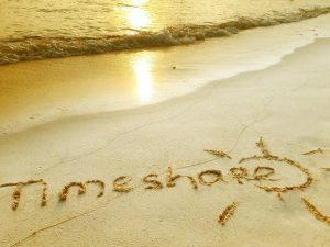 the word timeshare is written in sand on a beach